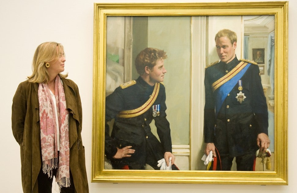 Artist Nicky Philipps stands with her work, 'Prince William and Prince Harry: a new portrait by Nicky Philipps' at the National Portrait gallery in central London, on January 6, 2010.