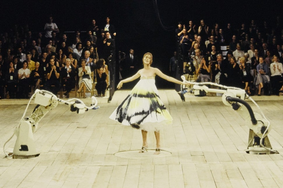 Alexander McQueen Shalom Harlow being sprayed my robots