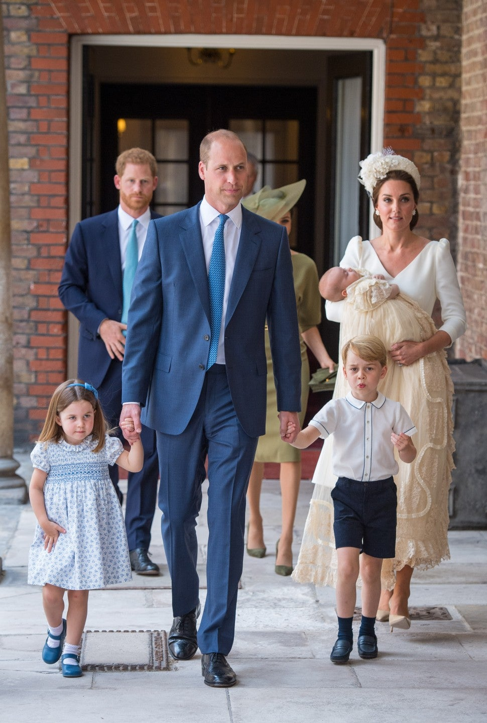 Princess Charlotte and Prince George hold the hands of their father, Prince William, Duke of Cambridge, as they arrive at the Chapel Royal, St James's Palace, London for the christening of their brother, Prince Louis, who is being carried by their mother, Catherine, Duchess of Cambridge