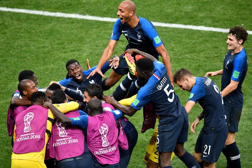 France's forward Kylian Mbappe celebrates with teammates after scoring a goal during the Russia 2018 World Cup final football match between France and Croatia at the Luzhniki Stadium in Moscow on July 15, 2018.