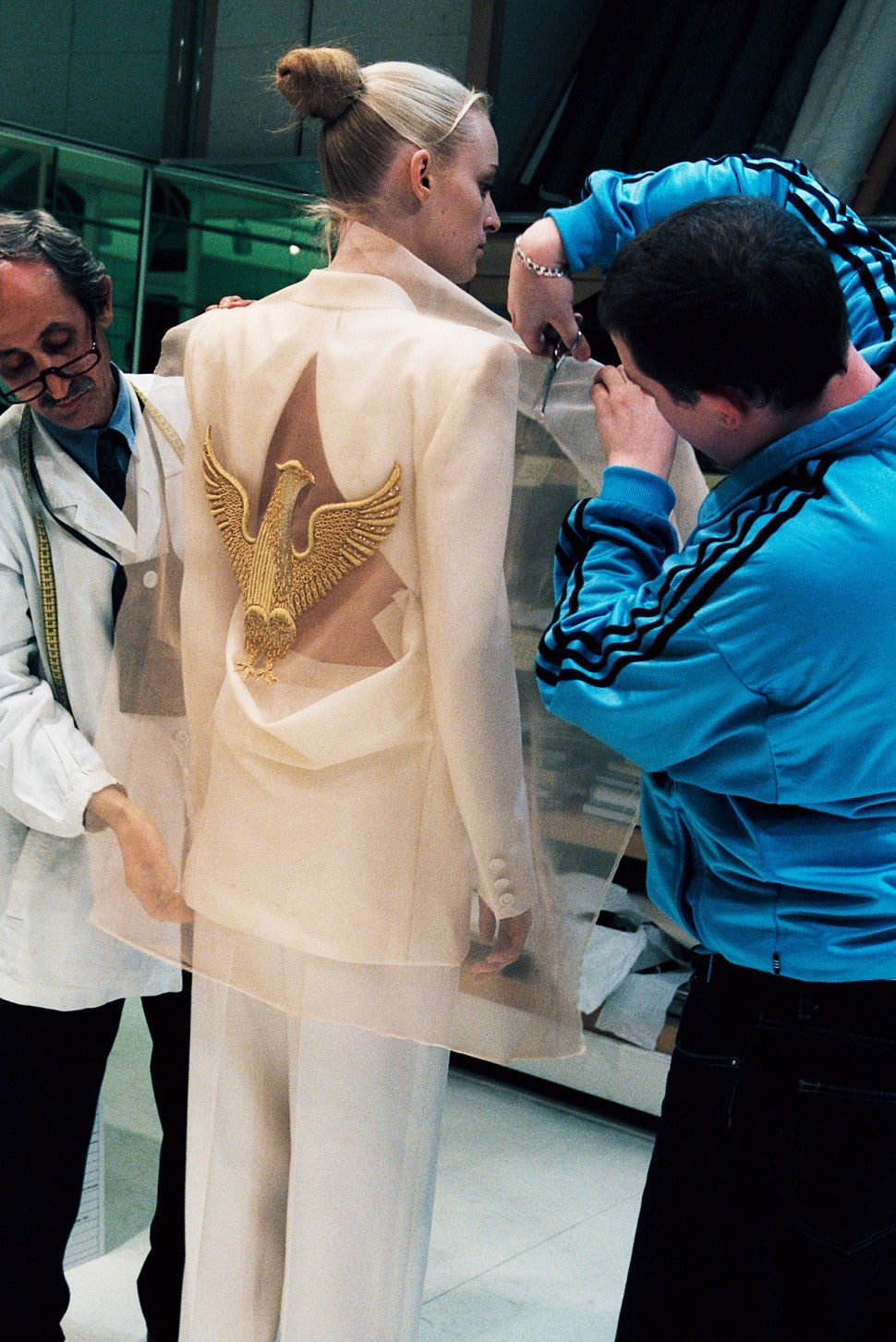 Alexander McQueen cutting fabric