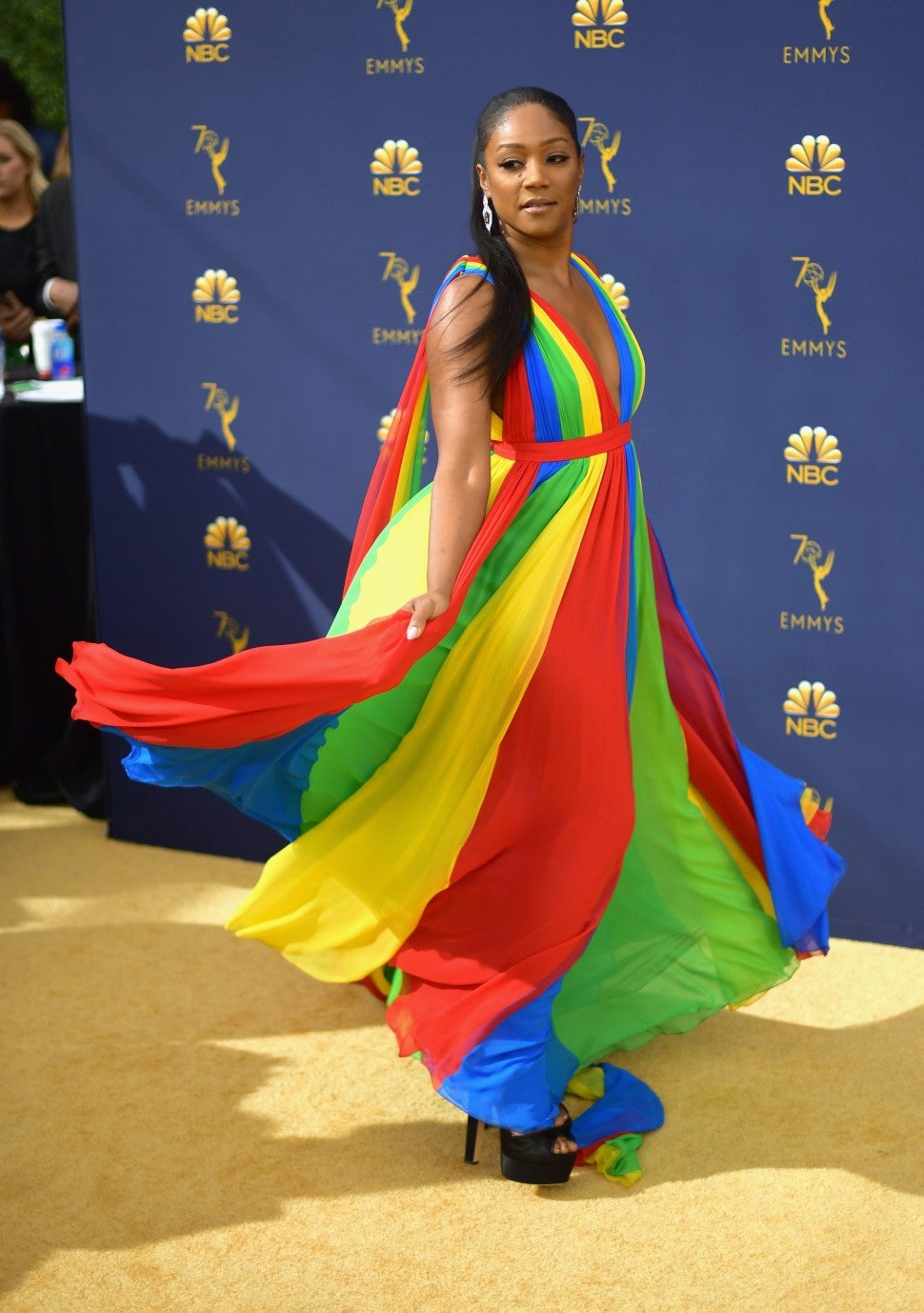 Tiffany Haddish twirling in rainbow dress