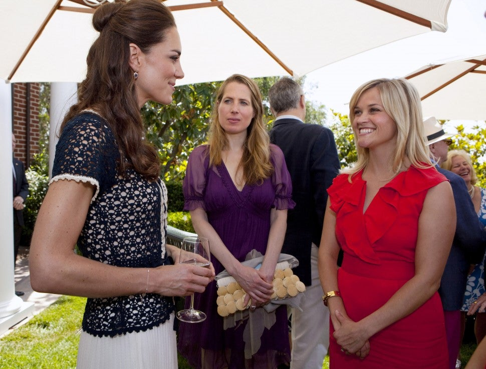 Catherine, Duchess of Cambridge speaks with Kristin Gore (C) and Reese Witherspoon during a reception to mark the launch of Tusk's US Patron Circle at the home of Steve Tisch on July 10, 2011 in Beverley Hill, California.