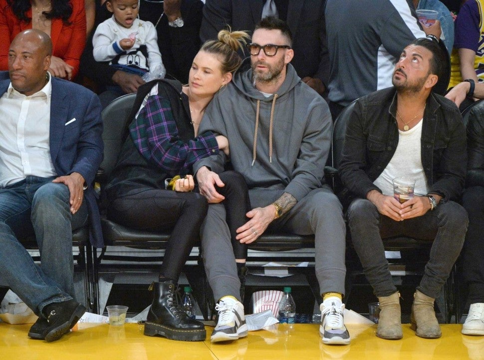 Adam Levine and Behati Prinsloo at the Los Angeles Lakers game at the Staples Center on Oct. 20