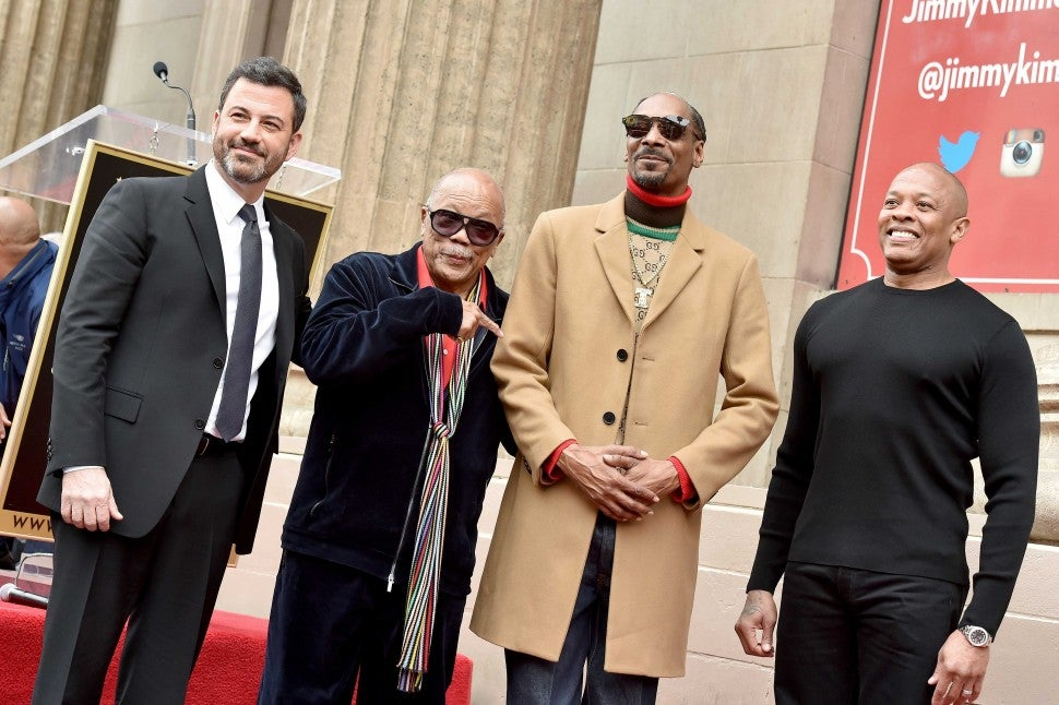 Jimmy Kimmel, Quincy Jones and Dr. Dre join Snoop Dogg as he gets his star on the Hollywood Walk of Fame on Nov. 19