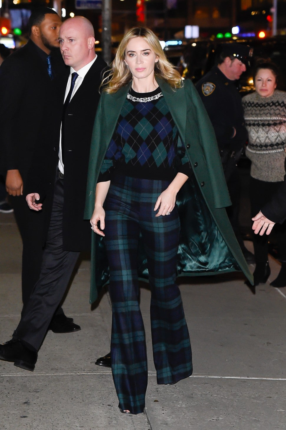 Emily Blunt in green coat and plaid
