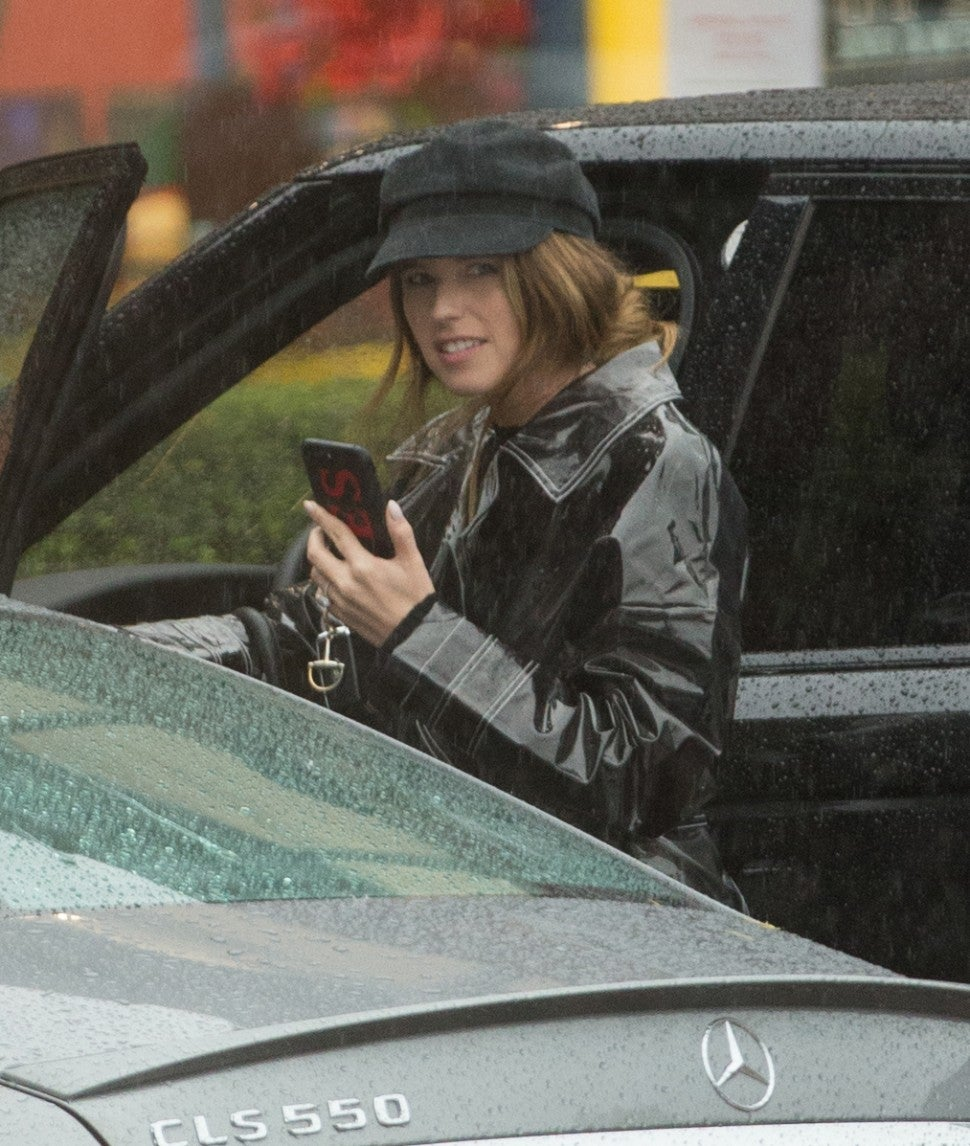 Katherine Schwarzenegger spotted out in the rain wearing new engagement ring.