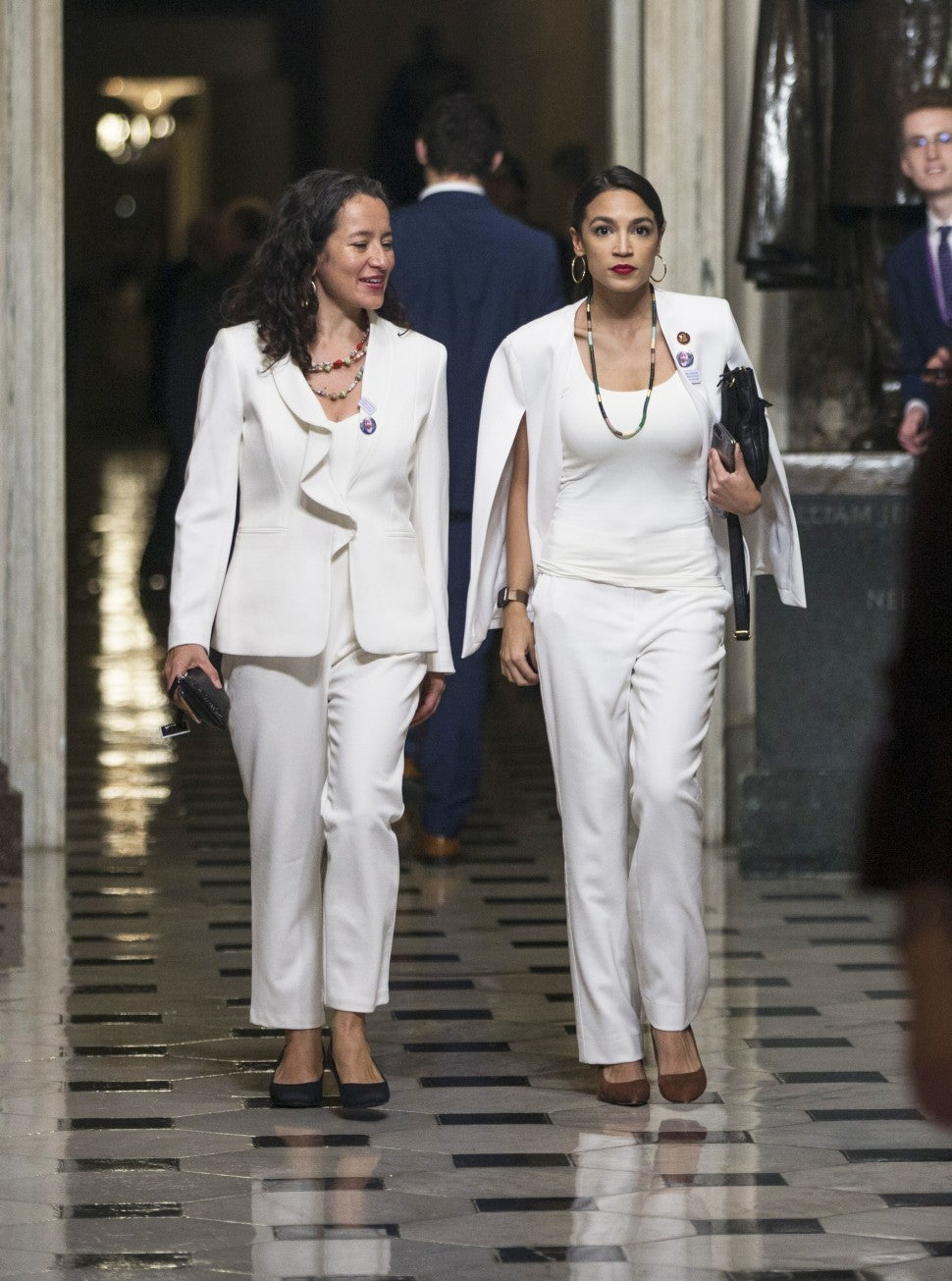 Alexandria Ocasio-Cortez in white cape jacket at State of the Union