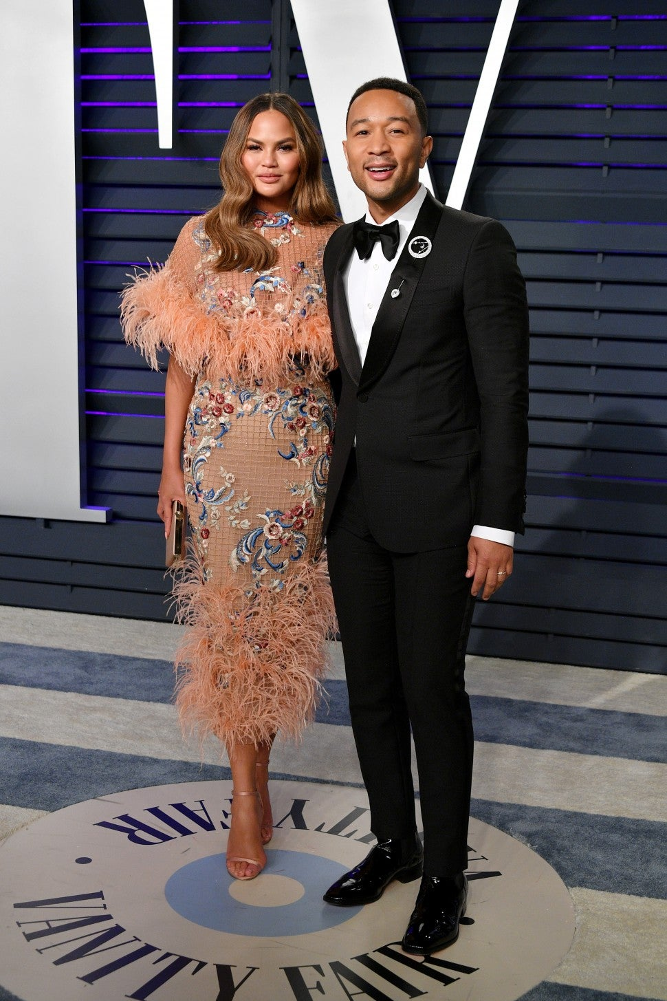 Chrissy Teigen and John Legend at vf party