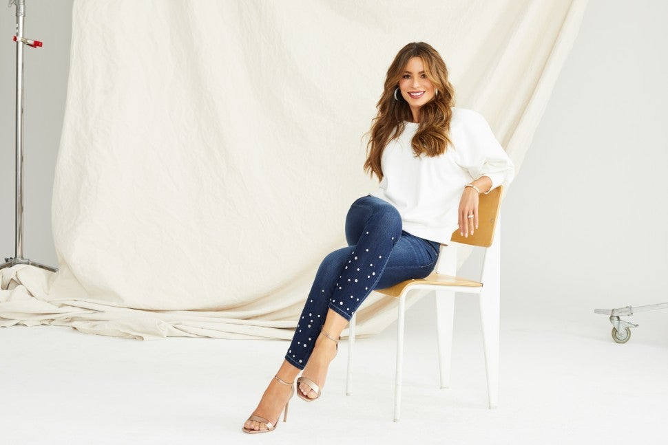 sofia_vergara_in_the_sofia_skinny_studded_mid_rise_stretch_ankle_jean-open_back_knit_banded_bottom.jpg