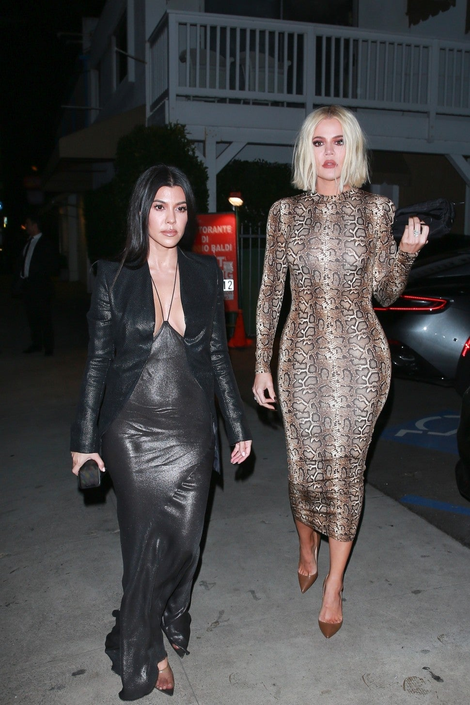 Kourtney Kardashian and Khloe Kardashian enjoy a night out