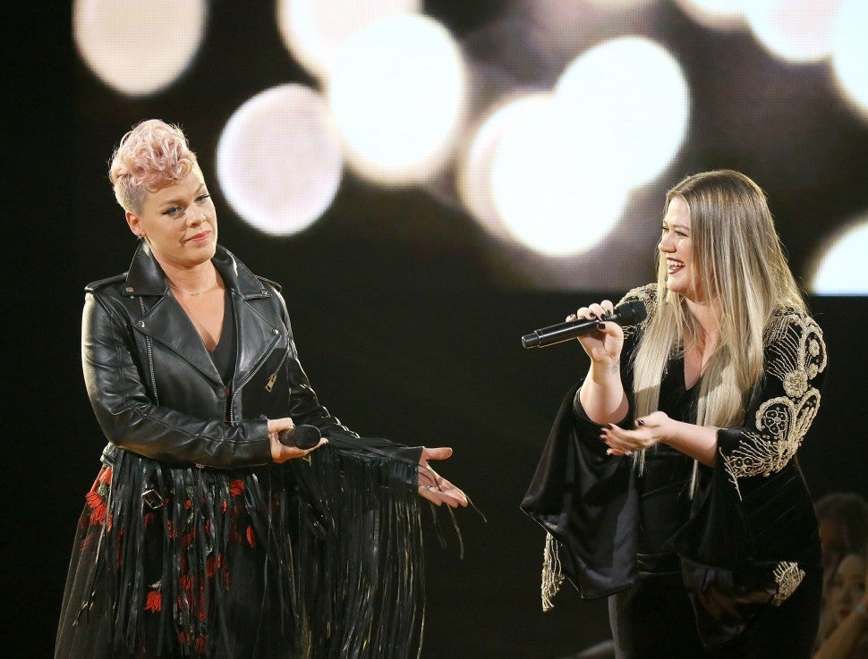 Pink and Kelly Clarkson perform onstage during the 2017 American Music Awards held at Microsoft Theater on November 19, 2017 in Los Angeles.