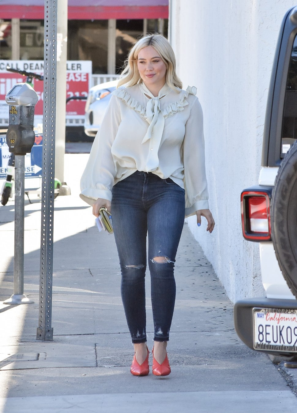 Hilary Duff in blouse and skinny jeans