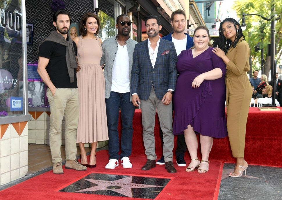 Milo Ventimiglia, Mandy Moore, Sterling K. Brown, Jon Huertas, Justin Hartley, Chrissy Metz, and Susan Kelechi Watson attend a ceremony honoring Mandy Moore with a star on the Hollywood Walk Of Fame on March 25, 2019