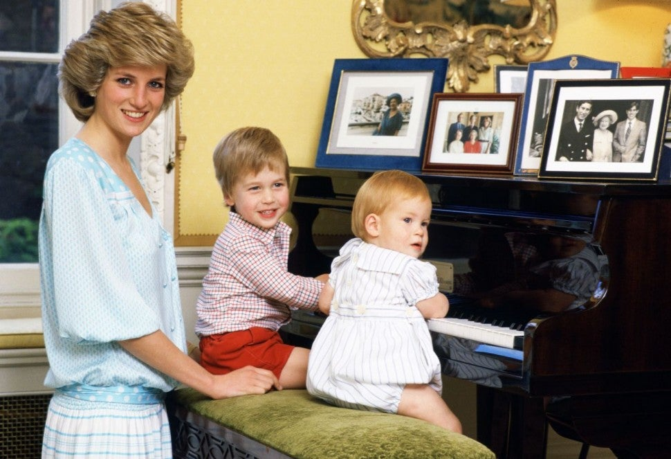Princess Diana with William and Harry as babies