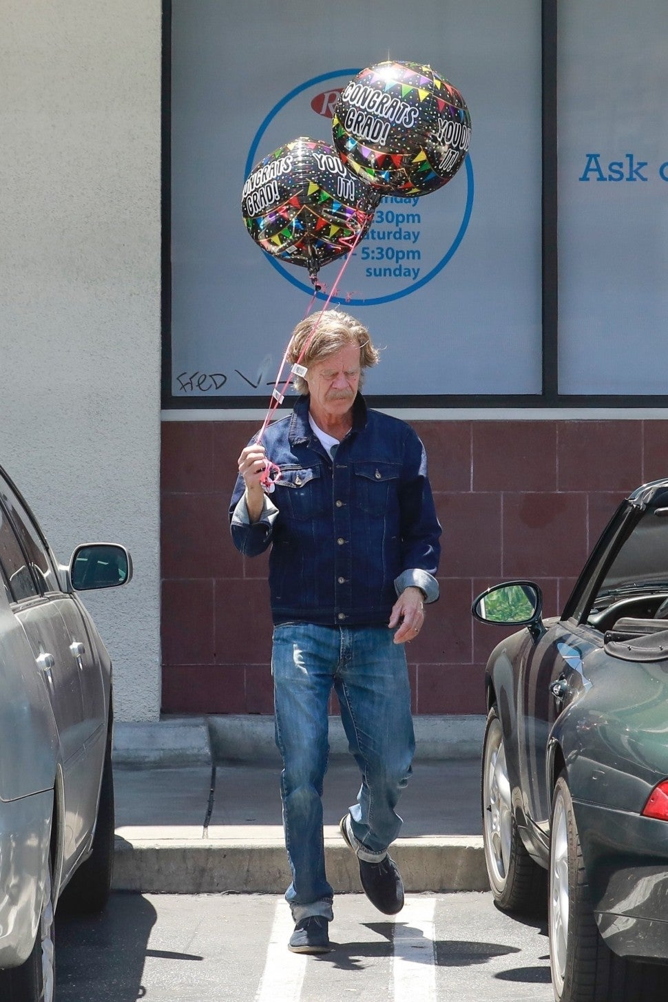 William H. Macy spotted gearing up for a graduation celebration while picking up balloons and a cake in Weho.