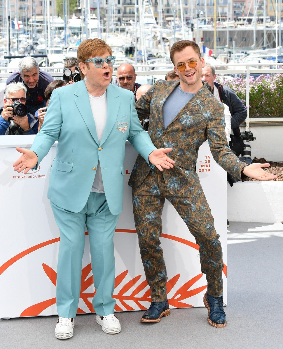 "Elton John and Actor Taron Egerton attend the photocall for ""Rocketman"" during the 72nd annual Cannes Film Festival on May 16, 2019 in Cannes, France."