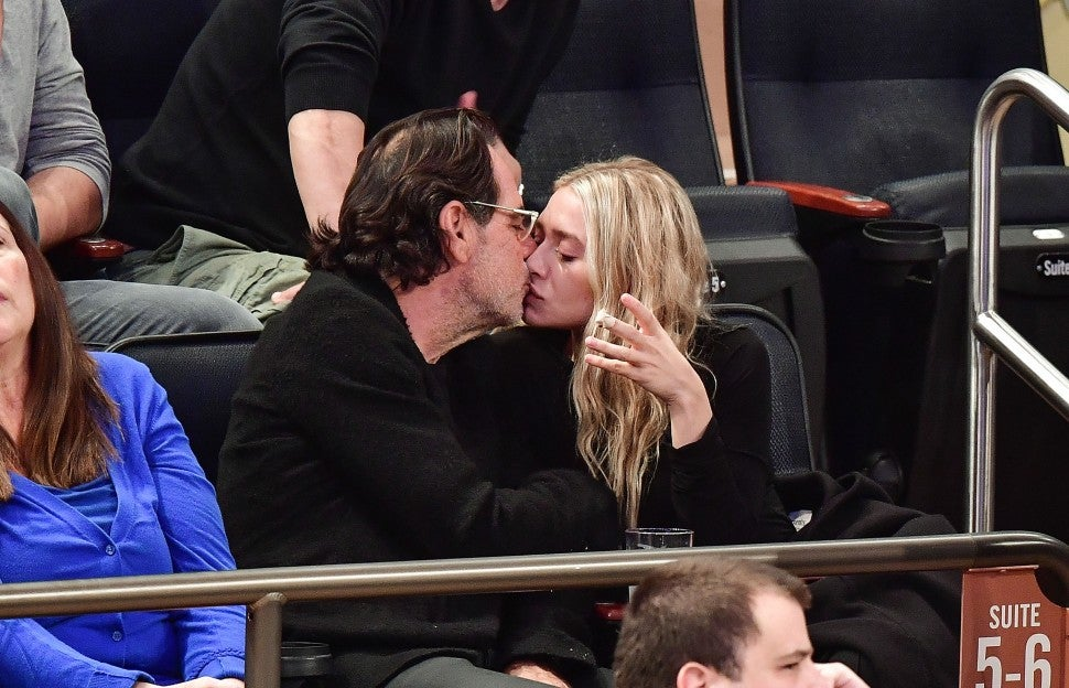 Ashley Olsen and Richard Sachs attend New York Knicks vs Brooklyn Nets game at Madison Square Garden on November 9, 2016 in New York City.