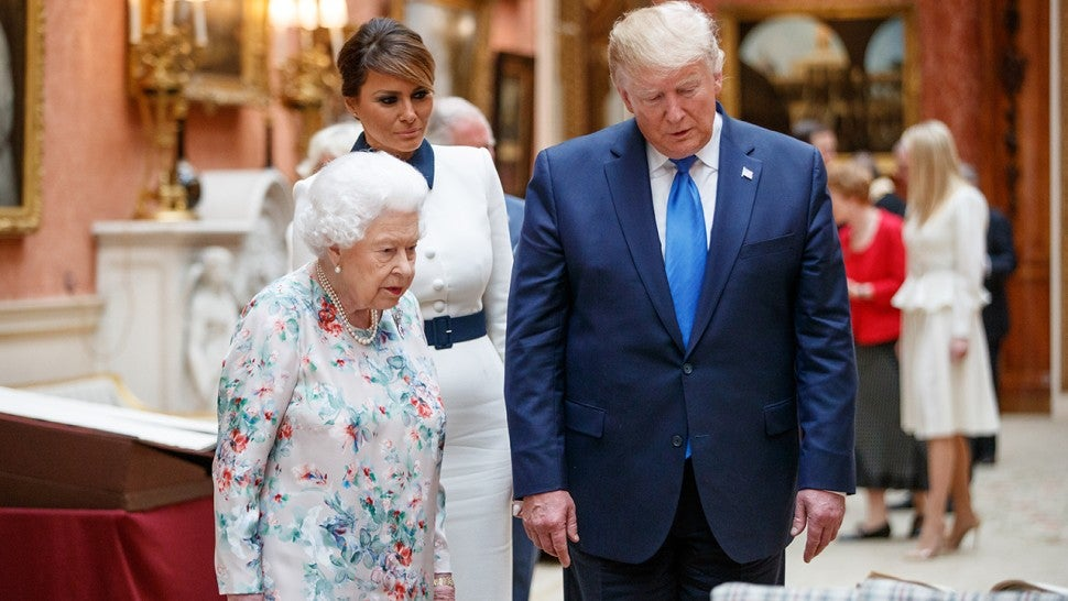 Queen Elizabeth II (L), US President Donald Trump (R) and US First Lady Melania Trump (C) view displays of US items of the Royal collection at Buckingham Palace on June 3, 2019 in London, England.