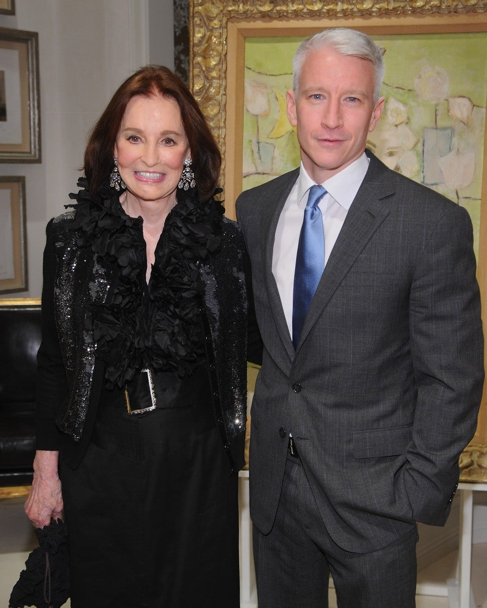 "Gloria Vanderbilt and Anderson Cooper attend the launch party for ""The World Of Gloria Vanderbilt"" at the Ralph Lauren Women's Boutique on November 4, 2010 in New York City"