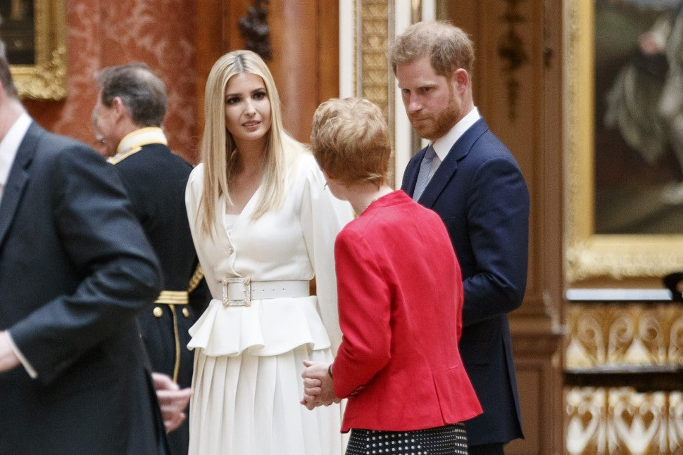 Ivanka Trump, daughter of US President Donald Trump, and Britain's Prince Harry, Duke of Sussex, view displays of US items of the Royal Collection at Buckingham Palace in London on June 3, 2019