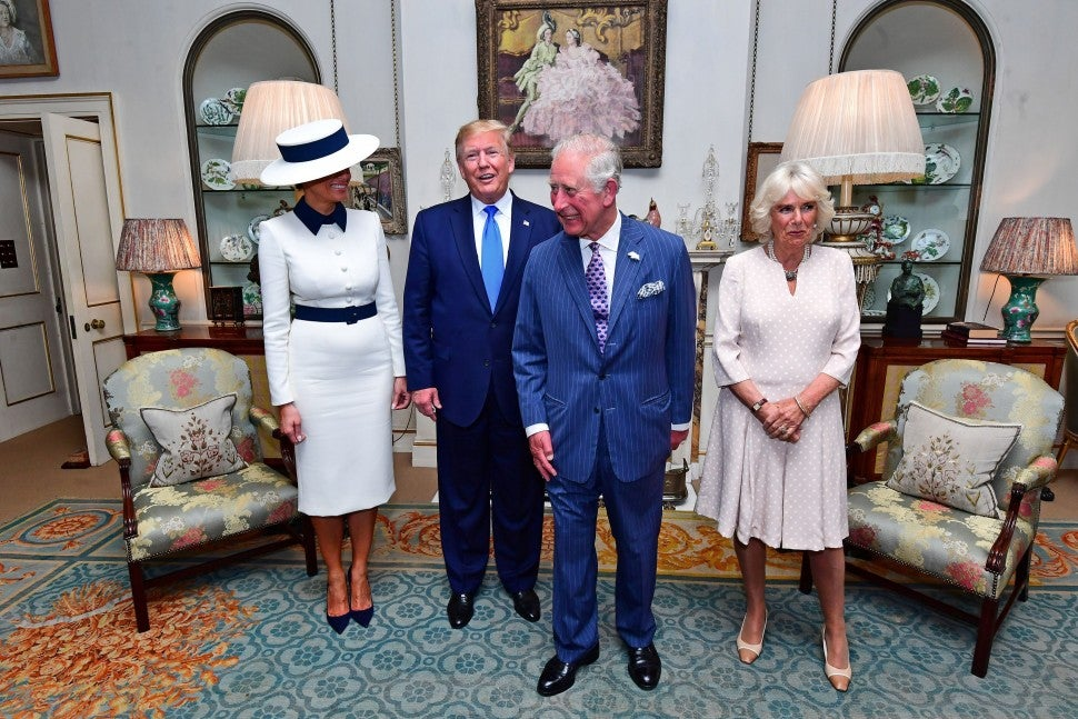 President Donald Trump and US First Lady Melania Trump pose for a photograph with their hosts, Britain's Prince Charles, Prince of Wales and Britain's Camilla, Duchess of Cornwall, before taking tea at Clarence House in central London on June 3, 2019.