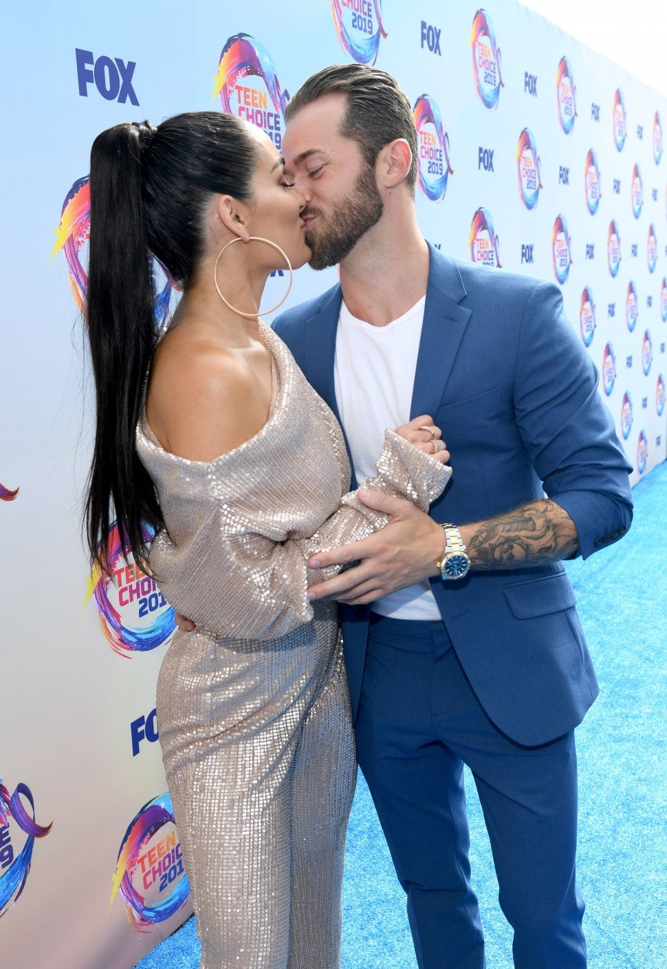 Nikki Bella and Artem Chigvintsev Kiss at the 2019 Teen Choice Awards