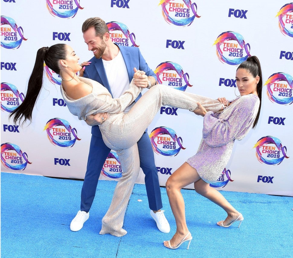 Nikki Bella, Artem Chigvintsev, Brie Bella at the 2019 Teen Choice Awards