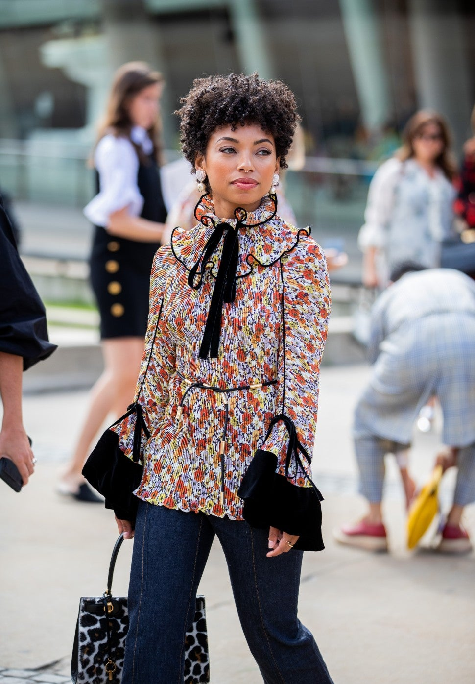 Logan Browning in printed blouse NYFW street style