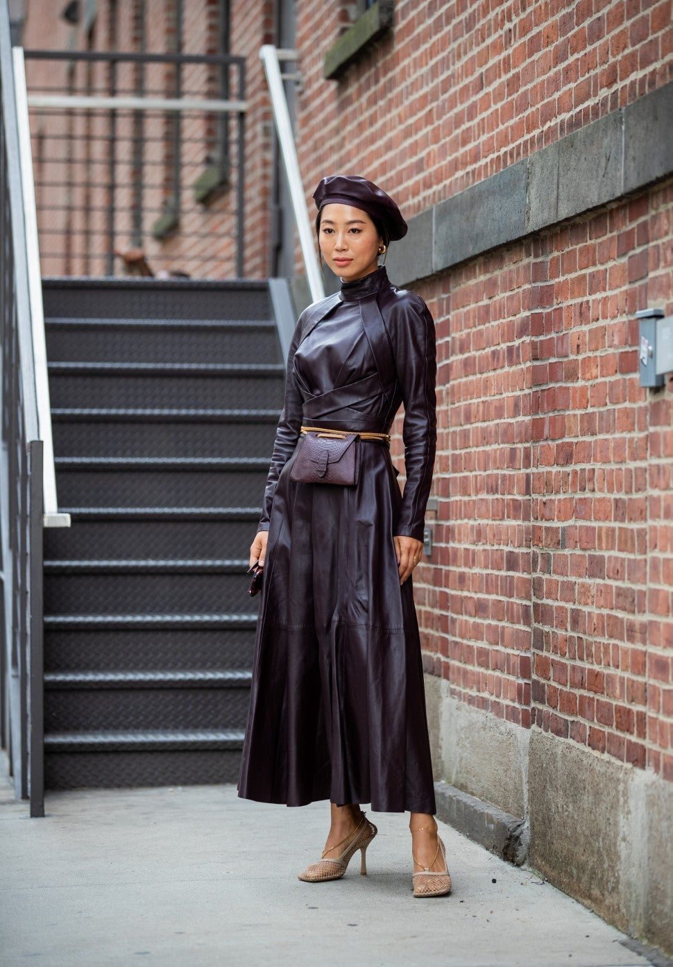 Aimee Song in leather outfit at NYFW street style