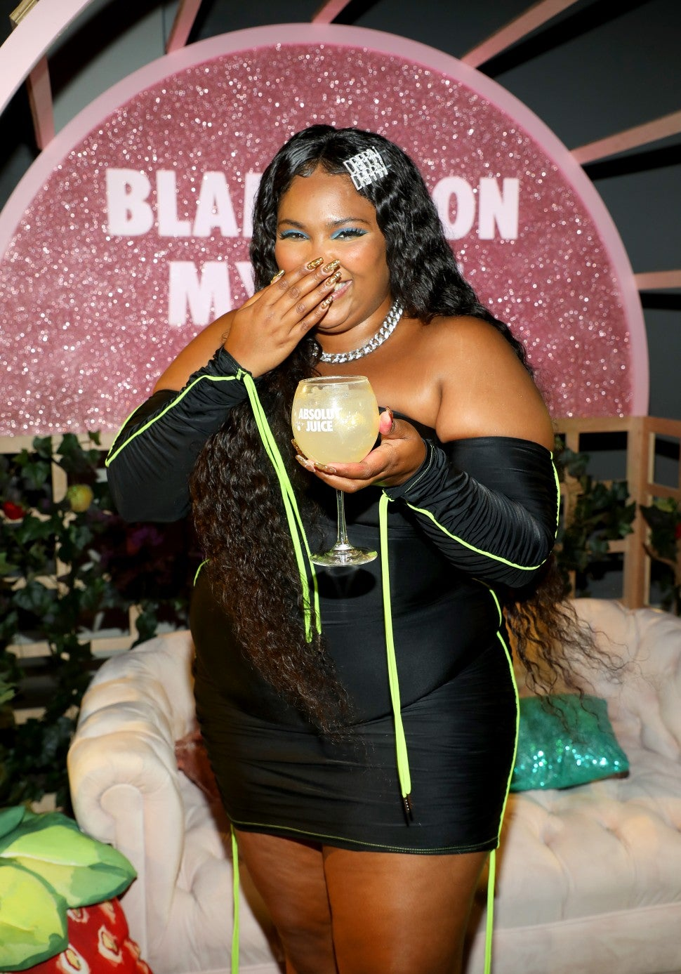 lizzo in miami with absolut juice