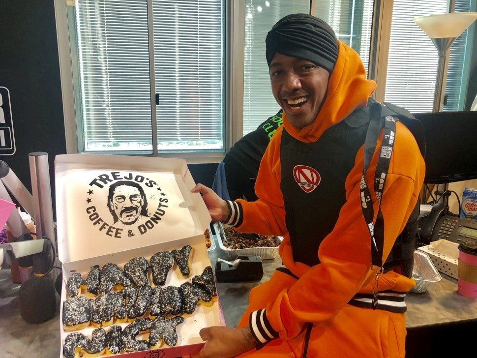 nick cannon with donuts