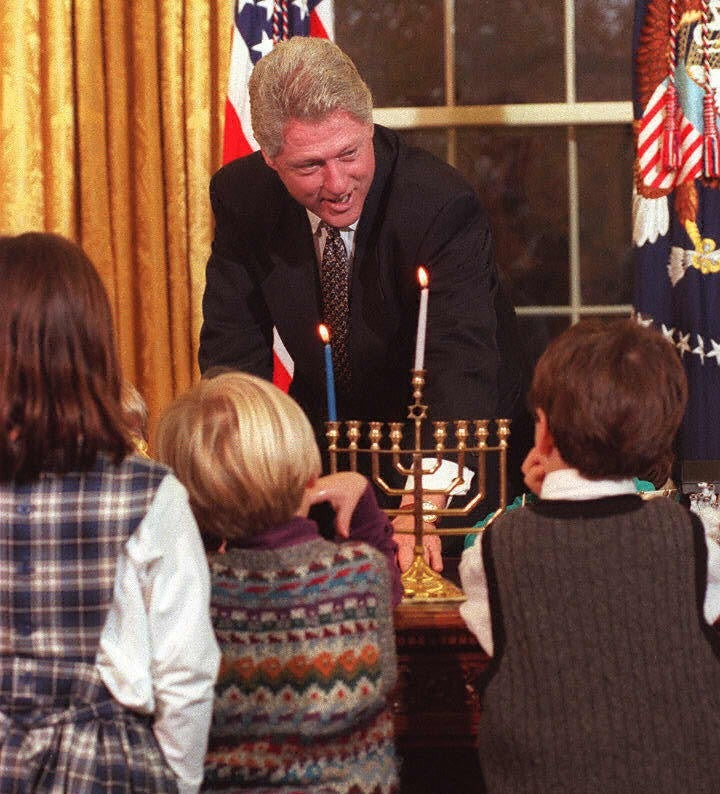 bill clinton lights menorah at white house in 1996