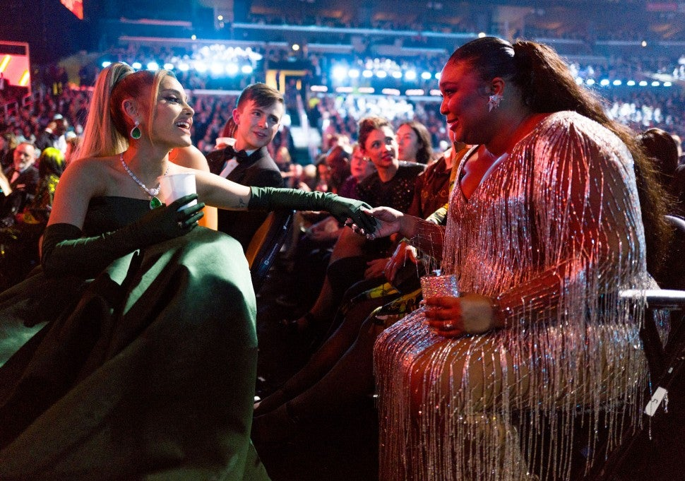 Ariana Grande and Lizzo attend the 62nd Annual GRAMMY Awards