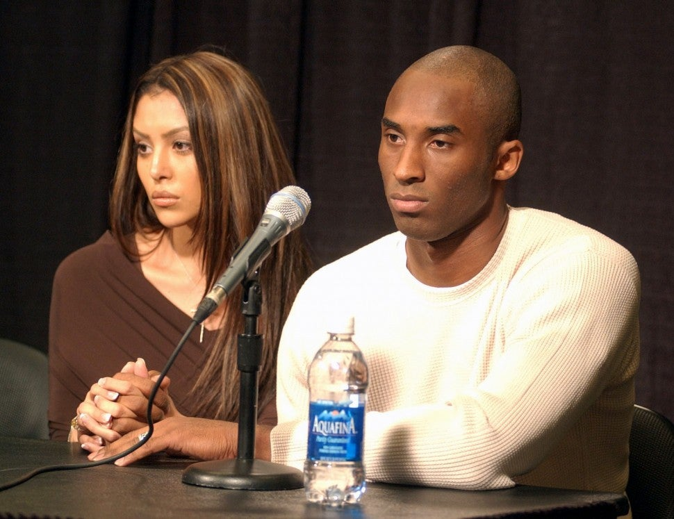 Kobe Bryant (left) with wife Vanessa at Staples Center press conference.