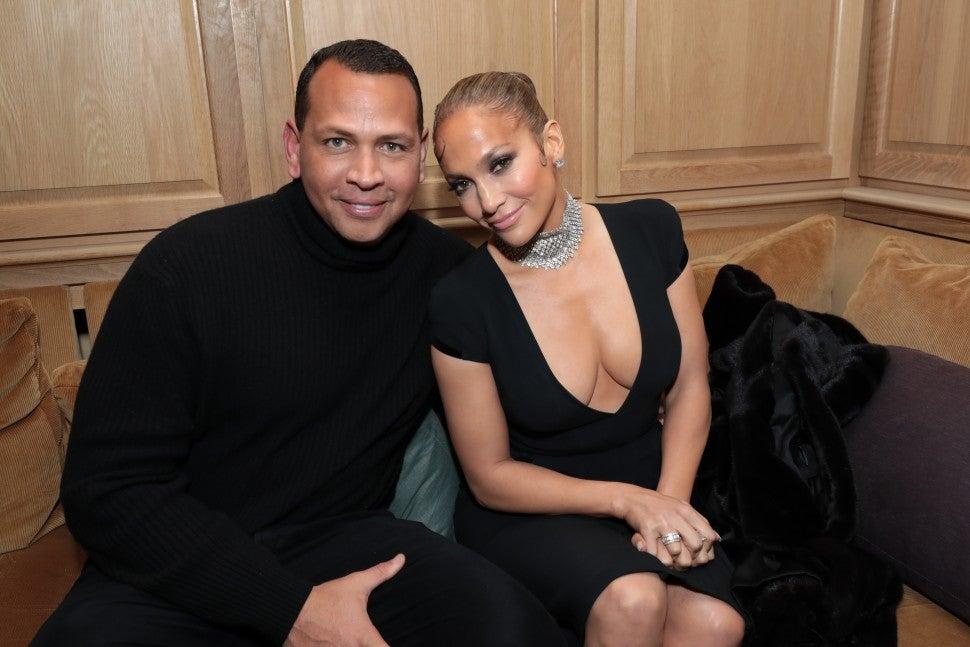 Alex Rodriguez and Jennifer Lopez at caa oscar party