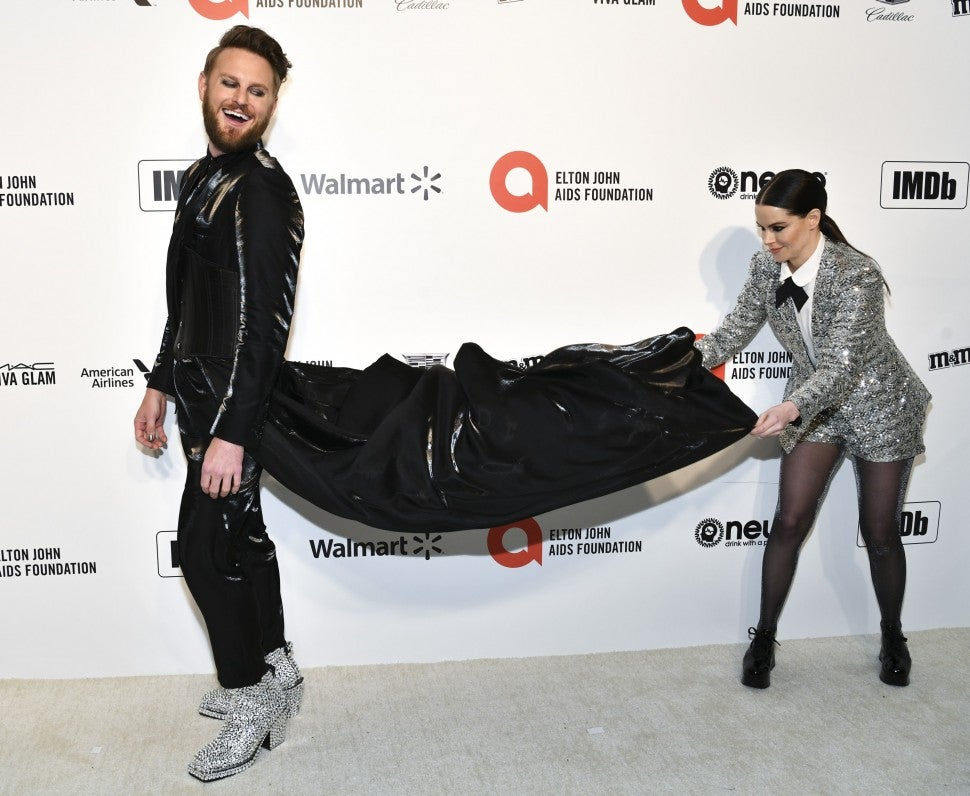 Bobby Berk and Emily Hampshire attend the 28th Annual Elton John AIDS Foundation Academy Awards Viewing Party Sponsored By IMDb And Neuro Drinks on February 09, 2020 in West Hollywood, California.