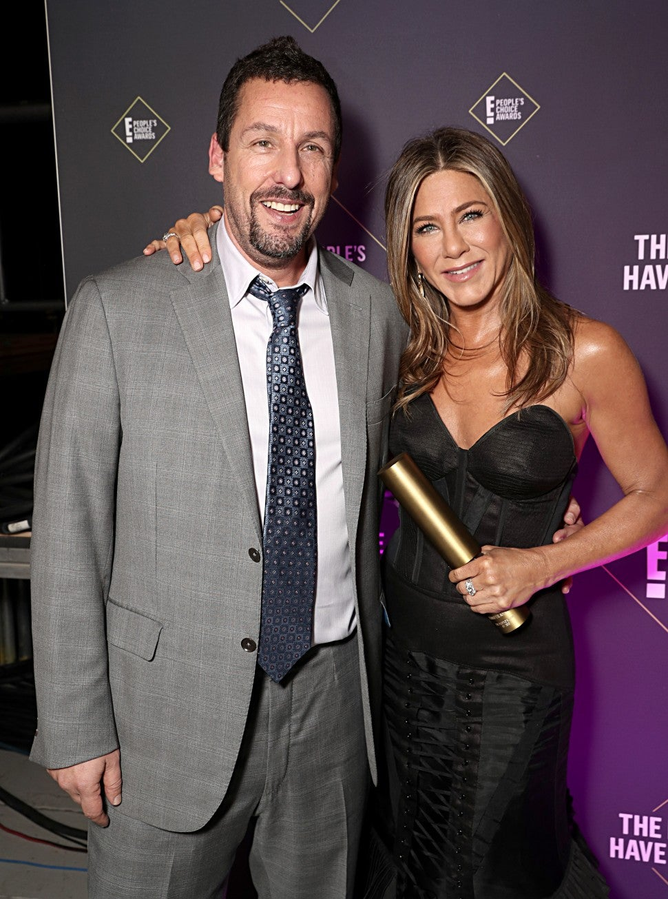 Adam Sandler and Jennifer Aniston pose backstage during the 2019 E! People's Choice Awards