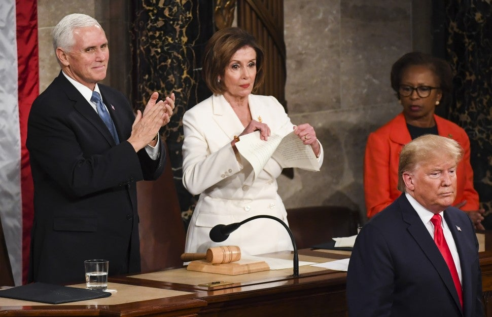 Nancy Pelosi (D-Calif.) rips tears up her advanced copy of President Donald J. Trump's State of the Union address