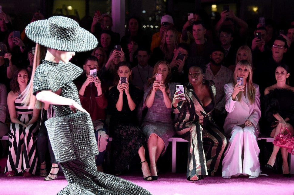 Leslie Jones and Heidi Klum sitting front row at Christian Siriano F/W 2020 fashion show