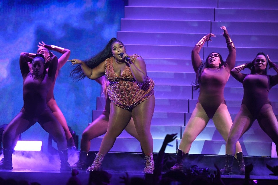 Lizzo performing at 2020 Brit Awards