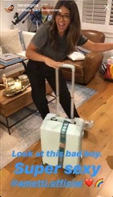 gina rodriguez with luggage