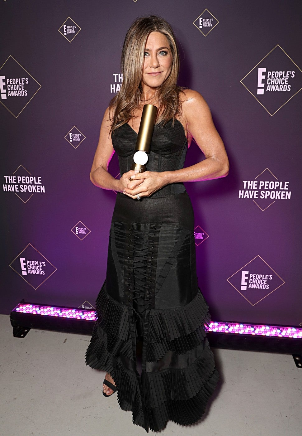 Jennifer Aniston poses backstage during the 2019 E! People's Choice Awards