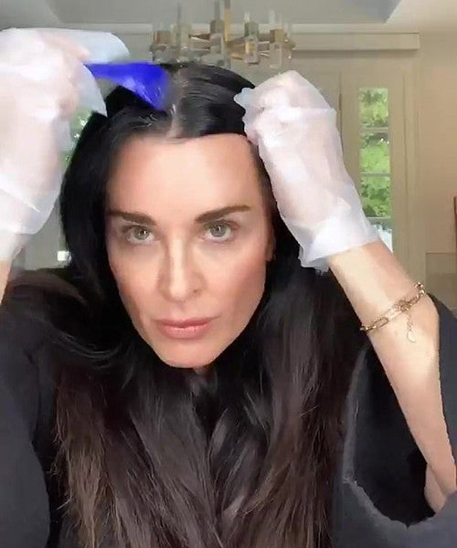 Kyle Richards dyeing her hair.