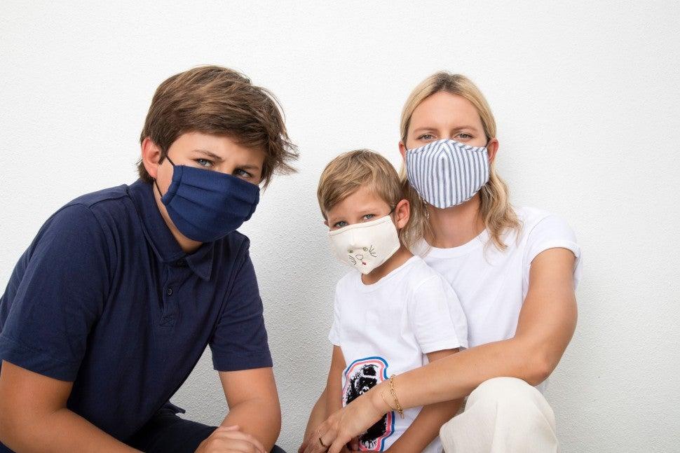 karolina kurkova and sons with masks