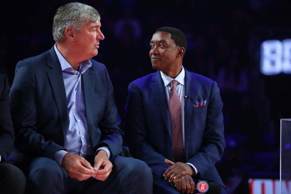 Former Detroit Piston Isiah Thomas talks to teammate Bill Laimbeer during a celebration of the 1989 and 1990 World Championship Detroit Pistons at halftime during a game between the Portland Trail Blazers and Detroit Pistons at Little Caesars Arena on March 30, 2019 in Detroit, Michigan