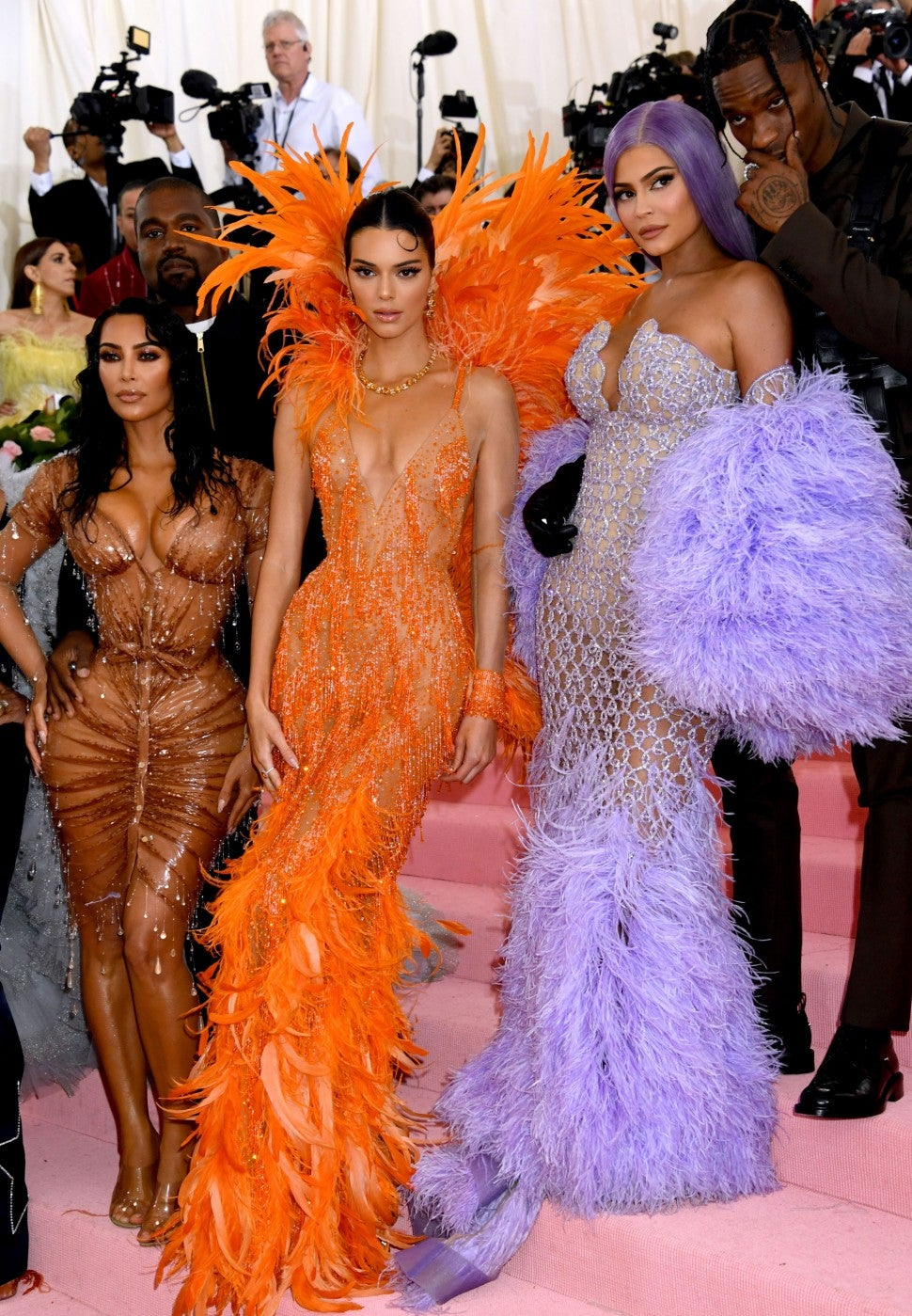 Kendall Jenner dons maxi-dress and raver-bun hairstyle to