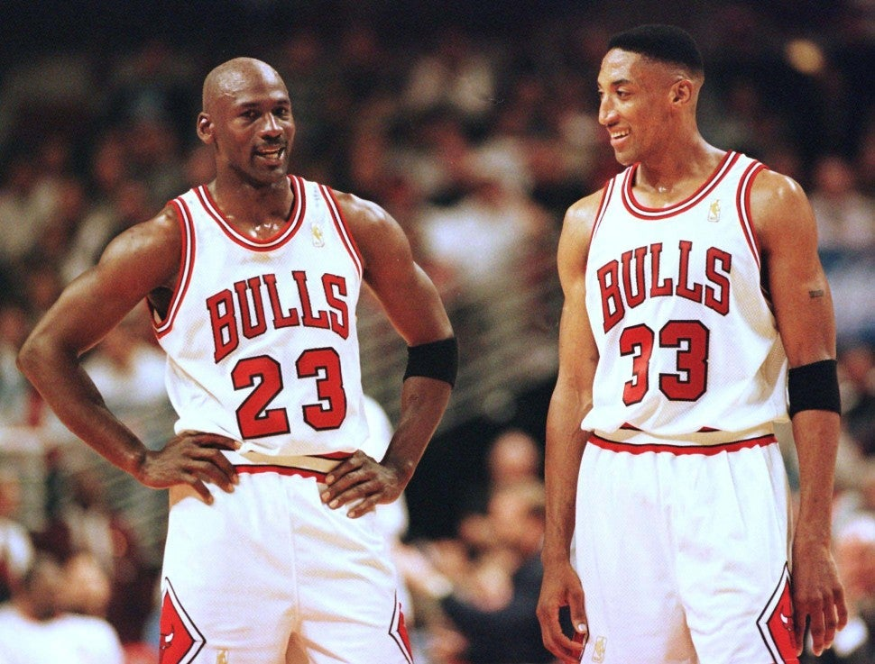 Michael Jordan and Scottie Pippen of the Chicago Bulls talk during the final minutes of their game 22 May in the NBA Eastern Conference finals aainst the Miami Heat at the United Center in Chicago, Illinois.