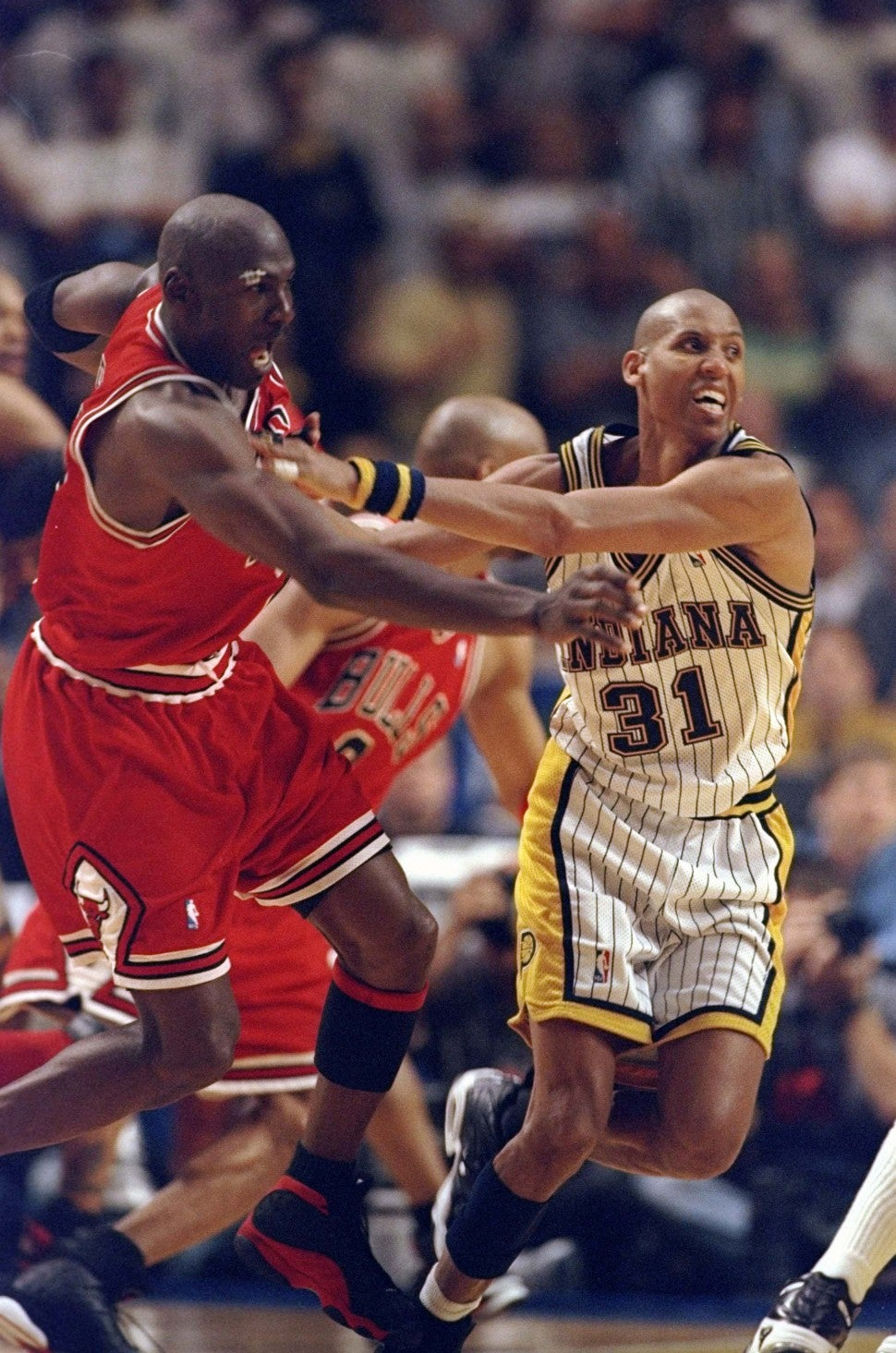 Reggie Miller #31 pushes Michael Jordan #23 for the winning 3 pointer of game six during the NBA Eastern Conference Finals at the Market Square Arena in Indianapolis, Indiana.