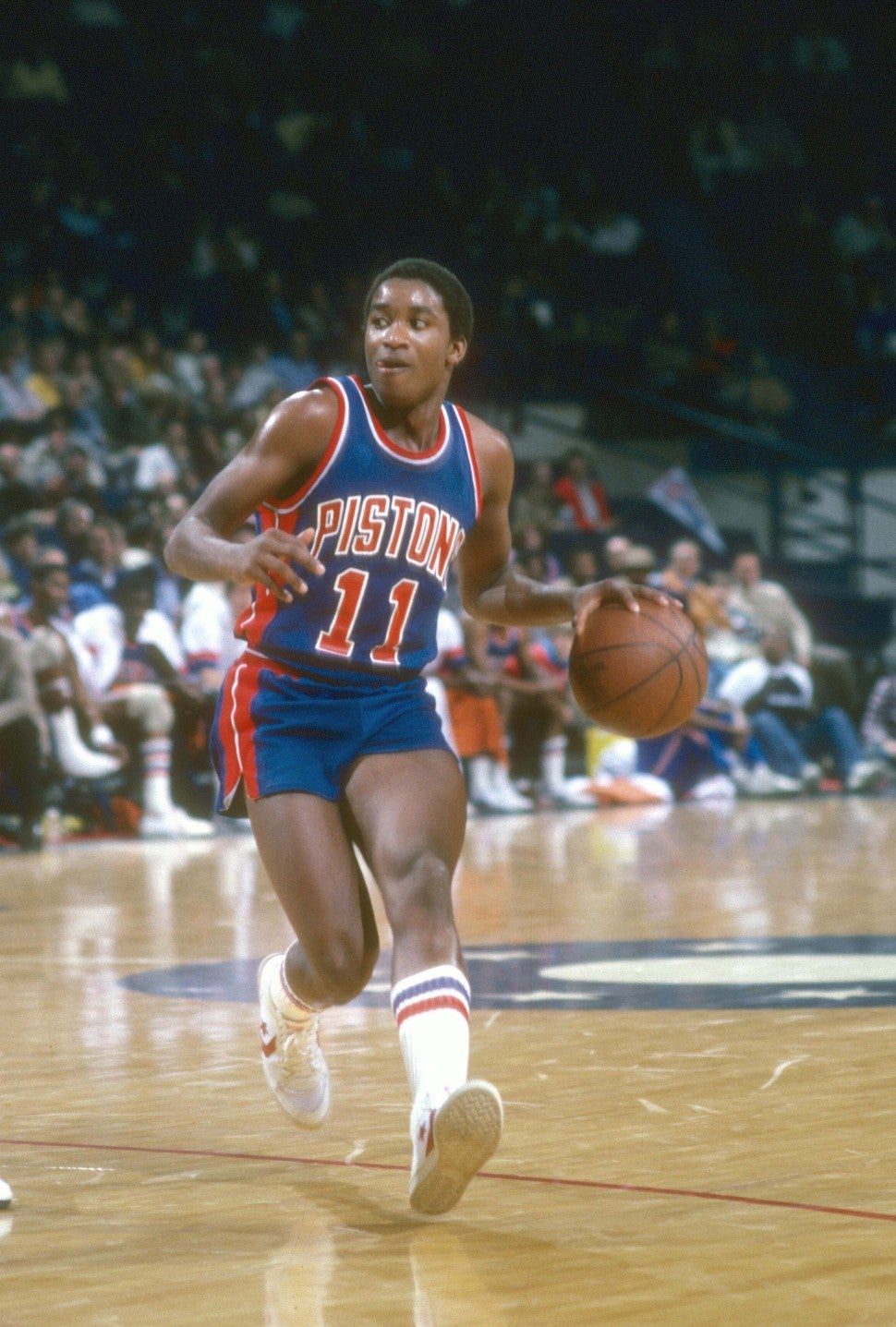 Isiah Thomas #11 of the Detroit Pistons dribbles the ball against the Washington Bullets during an NBA basketball game circa 1983 at The Capital Centre in Landover, Maryland.